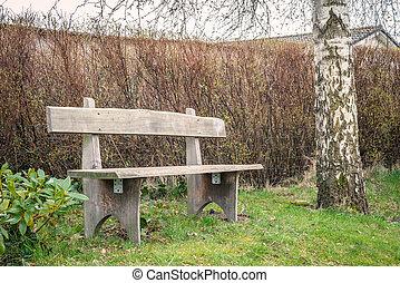 Wooden garden bench in the spring