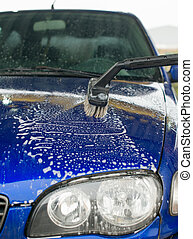 Car wash using special brush with soap.