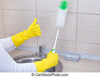Kitchen cleaning concept - Cleaning lady with protective...
