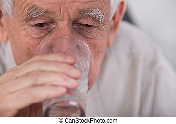 Old man drinking water - Close up of old man drinking water...