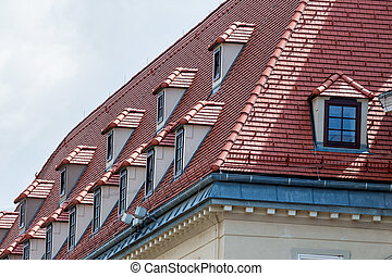 equipped penthouses with dormers, a symbol of modernization,...
