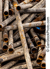 pipes in a junkyard - pipes waiting in a junkyard on their...