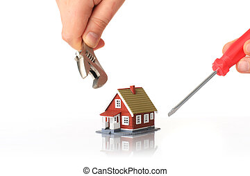 Fixing house. - Fixing house concept. Small house and tools...