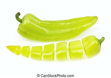 Pointy green pepper and one cut into pieces, on white...