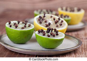 Lemon and limes with cloves, natural insect repellent...