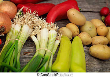 Various fresh raw vegetables on wooden surface