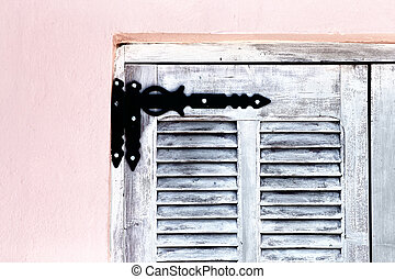 Hinge on wooden shutter - Close up of old-fashioned metal...