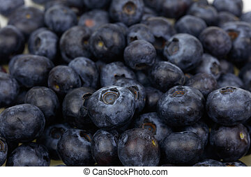 Stack of fresh blueberries closeup background