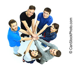 Top view of young people with their hands together in a...
