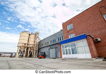 Concrete mixing tower of the factory producing concrete blocks