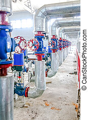 Steel pipelines and valves on factory producing blocks -...