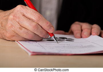 Businessman writing notes in the office