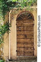 old wooden front door - wooden front door of a house in a...