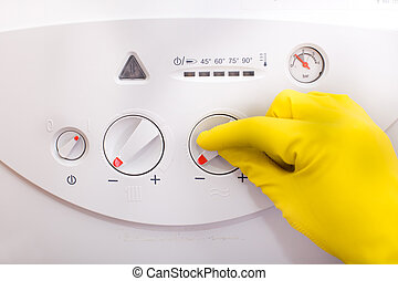 Controlling temperature in gas boiler - Close up of human...