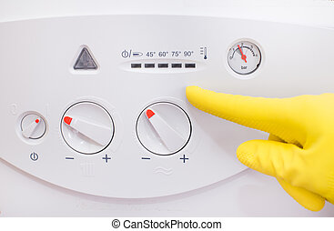 Gas boiler control panel - Close up of human hand with...
