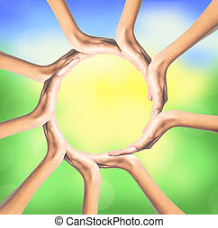 group of young people's hands over bright nature background