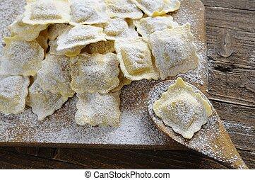 Preparing fresh ravioli. - Preparing fresh ravioli at the...