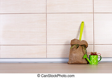 Sack and water pot on kitchen countertop - Small sacks with...