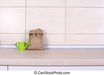 Sack and water pot on kitchen countertop - Small sack with...