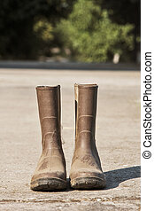 Brown boots - a pair of brown boots on the ground