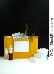 Allergy relief concept, seasonal pollen allergy, medication and paper tissues