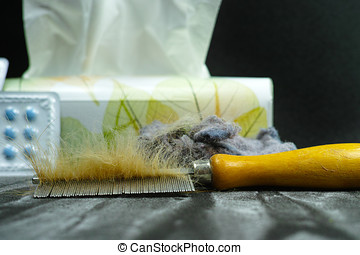 Allergy relief concept, home pets hair and dust as  allergens, medication and paper tissues