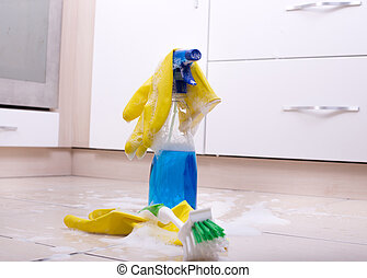 Cleaning supplies on tiled floor - Cleaning supplies on the...