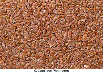Texture photo of reddish brown seeds of Linseed, also called...