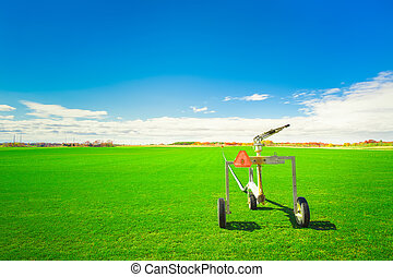 Sod Farm - Sod farm and sprinkler irrigation equipment on a...