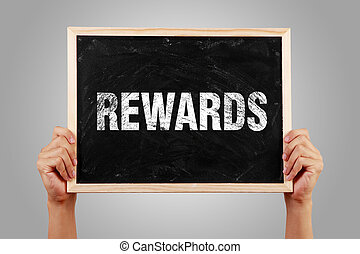 Rewards Text - Hands holding small blackboard with text...