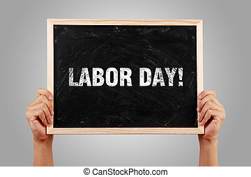 Labor Day - Hands holding small blackboard with text Labor...