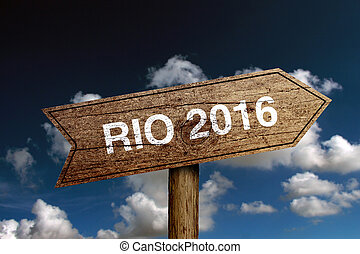 RIO 2016 - Wooden road sign with text RIO 2016 against blue...
