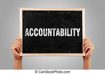 Accountability Text - Hands holding small blackboard with...