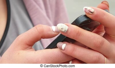 Closeup of young woman hands with smartphone Texting on cell...