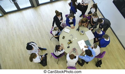 Students and teachers in a lesson - View from above of...