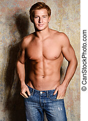 handsome young bodybuilder posing shirtless
