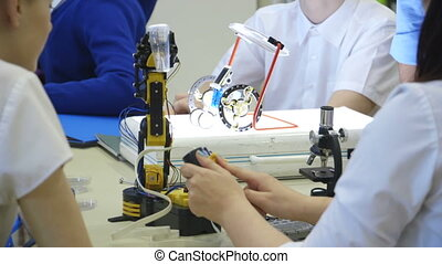 Students in a technology lesson - Students using robotic...