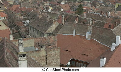 Old Tile Roofs - Pan shot over old tiles roofs in an old...