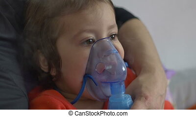 Child Doing Nebulizer Teraphy - Little children using a...