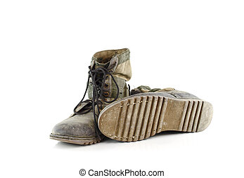 Old combat boots isolated on white background