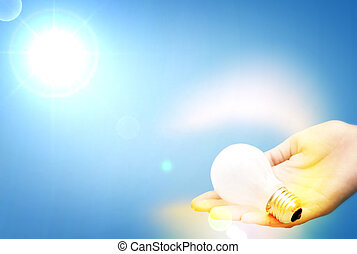 Background with lit lightbulb Isolated on blue