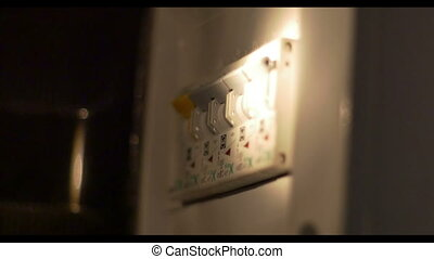 Switching Off the Electric Fuses - Man is turning off the...