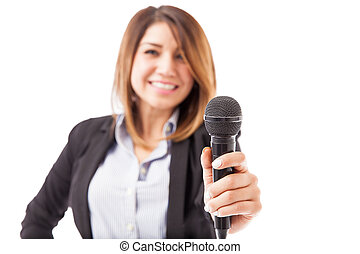 Female presenter handing over the microphone - Happy female...