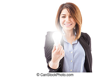 Businesswoman looking at an LED light bulb - Gorgeous young...