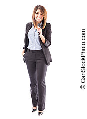 Successful female presenter with microphone - Full length...