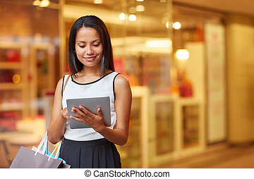Searching for more sales online - Portrait of a beautiful...