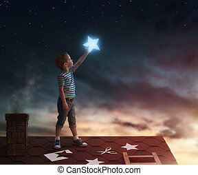 Boy on the roof - Fairy tale! The child hanging the stars in...
