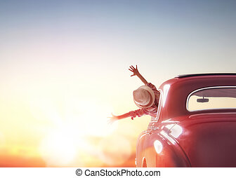 girl rides into the sunset - Toward adventure! Girl relaxing...