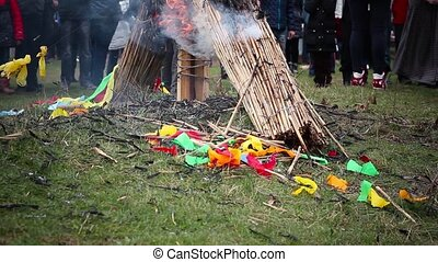 With a burning effigy fall colored ribbons, Burning Effigy...