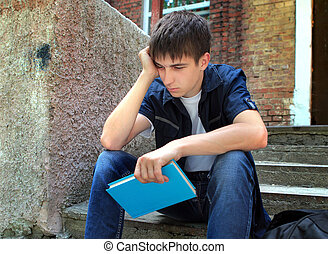 Sad Student with a Book - Sad Student with the Book on the...
